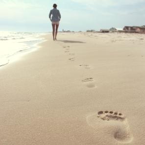woman footprints on beach